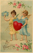 A vintage Valentine postcard with two angels holding a heart and — Stock Photo