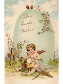 A vintage Easter postcard of a cupid making arrows and a large E — Stock Photo