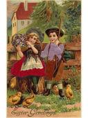 Een vintage pasen ansichtkaart van een kleine jongen en meisje omgeven door — Stockfoto