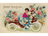 A vintage Easter postcard with a cherub riding an antique car fu — Stock Photo