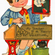 A vintage valentine of a little boy holding a picture of a dog — Stock Photo