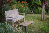 Garden bench and table — Stock Photo