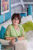 Attractive contemporary woman on sofa — Stock Photo