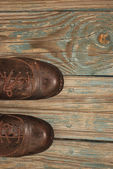 Retro footwear style on old porch boards — Stock Photo