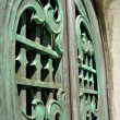 Green mausoleum doors — Stock Photo