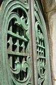 Green mausoleum doors — Stock Photo