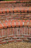 Curved brick garden benches — Stock Photo