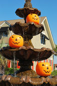 Pumpkin pails in fountain — Stock Photo