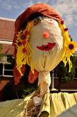 Flower child scarecrow — Stock Photo
