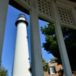 Lighthouse framed by gazebo window — Stock Photo