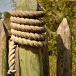 Stock Photo: Pointed stockade post wrapped with rope