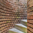 Stock Photo: Spiral stairs through curved brick walls