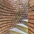 Stock Photo: Stairs spiraling through brick walls
