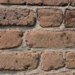 Irregular shaped bricks in mortar — Stock Photo