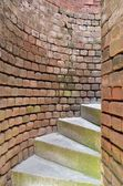 Stairs spiraling through brick walls — Stock Photo
