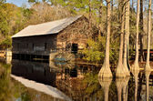 Grist mill and covered bridge — Stock Photo