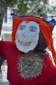Red headed scarecrow — Stock Photo