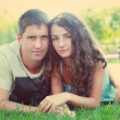 Cute young couple in a park — Stock Photo #12650309