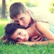 Cute young couple in a park — Stock Photo #12650324