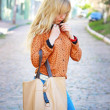 Blonde girl with a bag — Stock Photo
