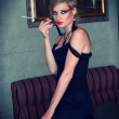 Blonde in a black dress — Stock Photo