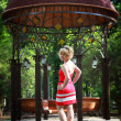 Girl in a park near the gazebo — Stock Photo
