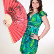 Attractive girl with red asian fan — Stock Photo
