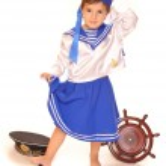 Cute girl in sailor dress — Stock Photo