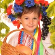 Stock Photo: Cute girl in ukrainian national dress and wreath