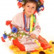 Cute girl in ukrainian national dress and wreath — Stock Photo #13227082