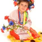 Cute girl in ukrainian national dress and wreath — Stock Photo