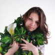 Young woman posing with flowers — Stock Photo