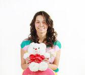 Joven bonita a mujer con oso de peluche — Foto de Stock