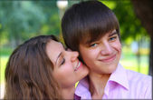 Happy Beautiful young couple smiling outdoor — Stock Photo