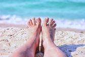 Feet on the beach — Stock Photo