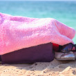 Beach things under a pink towel — Stock Photo
