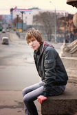 Young attractive man in urban background — Stock Photo