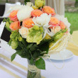 Stock Photo: Bouquet of flowers in vase on table