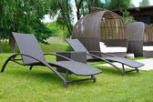 Sun beds and a sofa — Stock Photo