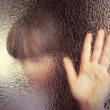 Hand behind frosted glass — Stock Photo #48157741