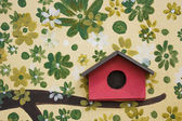 Red wooden bird house — Stock Photo