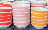 Stacks of colorful cups in warehouse — Stok fotoğraf