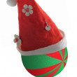 Santa claus hat with christmas ball — Stock Photo