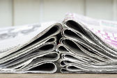 Closeup pile of newspaper — Stock Photo