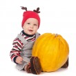 Cute baby boy in funny deer hat with orange pumpkin on white — Stock Photo #13338643