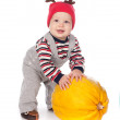 Cute baby boy in funny deer hat with orange pumpkin on white — Stock Photo #13338645