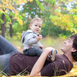 Dad playing with son on autumn outdoor — Stock Photo