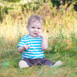 Baby sitting on grass — Stock Photo #13338710