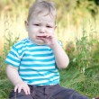 Baby sitting on grass — Stock Photo #13338711