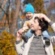 Father and son in park — Stock Photo #13338712